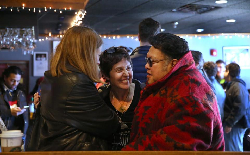 Johnny D's owner Carla DeLellis (center) chatting with patrons Lisa McGinnis and her husband, Michael Soria, during the jazz brunch.